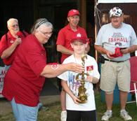 Grayson Fisher receives the 2011 Tug Trophy from Miss Janet while Bigdog and runners up Jeff Silvey and Larry Gray look on.